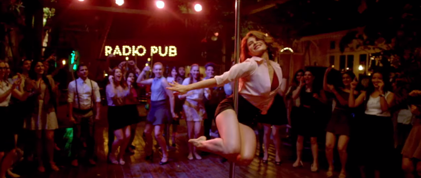 Jacqueline fernandez in A Gentleman doing pole dance in pub